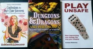 Tre bøger: Selvbiografi om rollespil, guide til bedre rollespil og filosoferen over rollespil.
